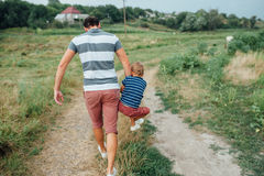 Happy father and son playing together Royalty Free Stock Photography
