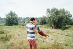 Happy father and son playing together royalty free stock images