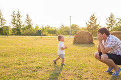 Happy father and son portrait playing together having fun.  royalty free stock photo