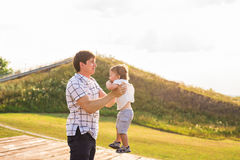Happy father and son portrait playing together having fun.  stock images