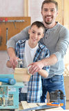 Father and son in carpentry workshop Royalty Free Stock Photos