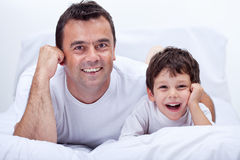 Happy father and son relaxing Stock Images