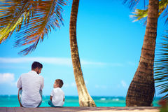 Happy father and son sitting together near the seaside Stock Images