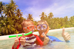 Happy father and son snorkeling on beach Stock Photography