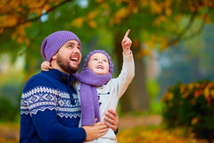 Happy father and son spending time together in autumn park Royalty Free Stock Photography