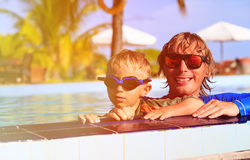 Happy father and son swimmimng in the pool Royalty Free Stock Image