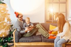 Happy father and son with tablet pc computer playing at home Royalty Free Stock Images