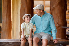 Happy father with son talking and having rest outdoors in city Stock Photography
