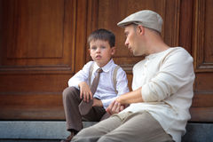 Happy father and son talking outdoors in city Royalty Free Stock Photos