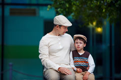 Happy father and son talking outdoors in city Stock Images