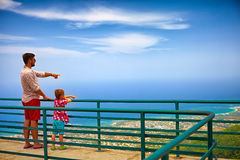 Happy father and son, tourists enjoying the fascinating view on Atlantic ocean coastline from observation deck of Pico Isabel de T Royalty Free Stock Images