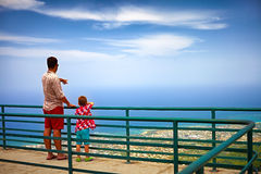 Happy father and son, tourists enjoying the fascinating view on Atlantic ocean coastline from observation deck of Pico Isabel de T Royalty Free Stock Photos