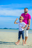 Happy father and son at the tropical beach, laughing and enjoing time together. Royalty Free Stock Photos