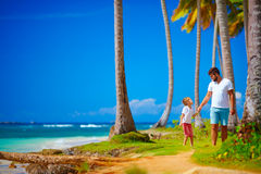 Happy father and son walking on the paradise island Royalty Free Stock Photos