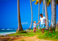 Happy father and son walking on the paradise island Stock Photography