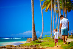 Happy father and son walking on the paradise island Royalty Free Stock Photography