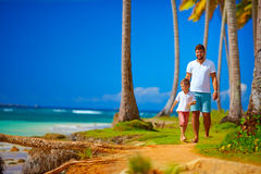 Happy father and son walking on the paradise island Stock Photo