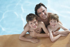 Happy Father With Sons In Swimming Pool Royalty Free Stock Photo
