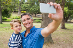 Happy father taking a selfie with his son Royalty Free Stock Image