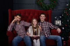 Happy father with teenage daughter and son are sitting in front royalty free stock images