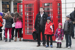 Happy father with three children out of the children`s store at Covent Garden Royalty Free Stock Image