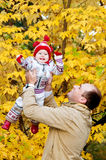 Happy Father tossing up his little daughter Royalty Free Stock Photos