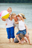 Happy father with two children on vacation. On a beach at a sea Royalty Free Stock Photography