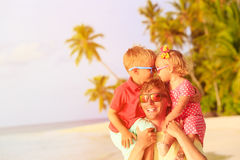Happy father with two kids on shoulders having fun Stock Images