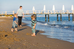 Happy father and two little sons having fun at beach vacation Royalty Free Stock Images