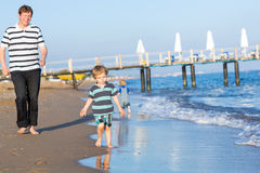 Happy father and two little sons having fun at beach vacation Royalty Free Stock Photos