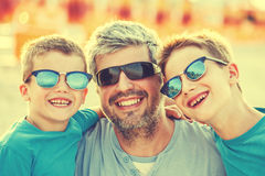 Happy father with two sons vintage Royalty Free Stock Photography