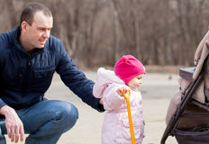 Happy father walking with pretty beautiful little girl Stock Photo