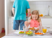 Happy father withpretty daughter having fun breakfast Royalty Free Stock Image