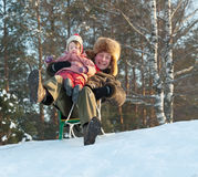 Happy father with 2 years child playing on slide Stock Image