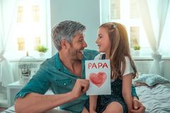Happy fatherhood. Fathersday surprising little cute girl royalty free stock images
