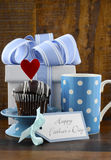 Happy Fathers Concept with blue and white gift and cupcake. Stock Photo