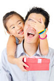 Happy fathers day. Asian girl giving surprise gift to her father on fathers day Stock Photo
