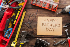 Happy Fathers Day background, card on rustic wood with repair tools Stock Photos