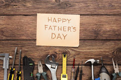 Happy Fathers Day background, card on rustic wood with repair tools. And other man things Stock Photo