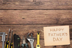 Happy Fathers Day background, card on rustic wood with repair tools. And other man things Stock Images