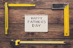 Happy Fathers Day background, card on rustic wood with repair tools. And other man things Royalty Free Stock Images