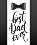 Happy fathers day background with greeting lettering and bow tie. Stock Image