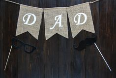 Happy Fathers day banner on the brown vintage wooden background. word Dad wriiten on the flags. royalty free stock photos