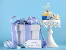 Happy Fathers Day blue butterfly theme cupcake on white cupcake stand Stock Photo