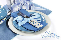 Happy Fathers Day blue theme table setting with gift. On white with sample text or copy space for your text here royalty free stock photography