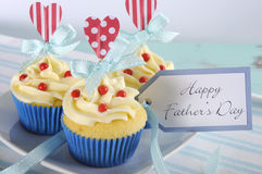 Happy Fathers Day bright and cheery red white and blue decorated cupcakes - closeup. Happy Fathers Day bright and cheery red white and blue decorated cupcakes stock images