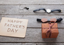 Happy Fathers Day card on rustic wood background Stock Images