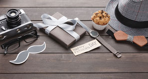 Happy Fathers Day card on rustic wood background. Happy Fathers Day background, flat lay with male presents, watch and other man things on rustic wood royalty free stock photography