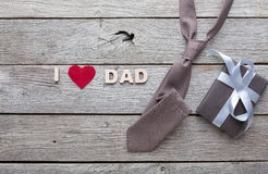 Happy Fathers Day card on rustic wood background. Happy Fathers Day card with male presents, love dad letters, watch and other man things on rustic wood royalty free stock image