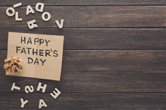 Happy Fathers Day card on rustic wood background Stock Photo